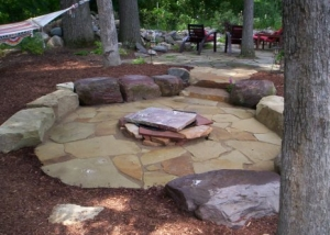 Flagstone patio with stone benches