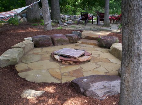 Flagstone Patio with natural outcropping stone benches.