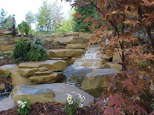 Waterfall stone backyard pond stone water feature for Stone garden waterfall