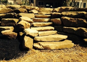Stone boulder wall and second steps