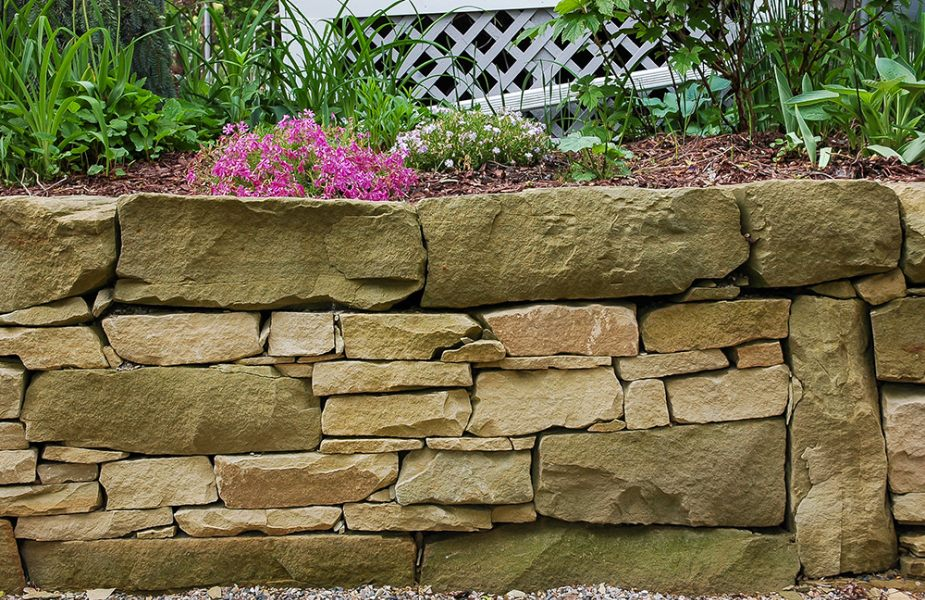 stone retaining wall using mix of stone retaining wall products by Napoleon Stone