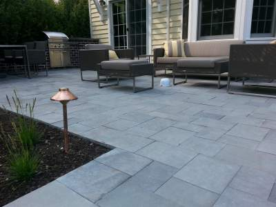 Bluestone patio using blue blue bluestone pavers at different sawn dimensions by Napoleon Stone.